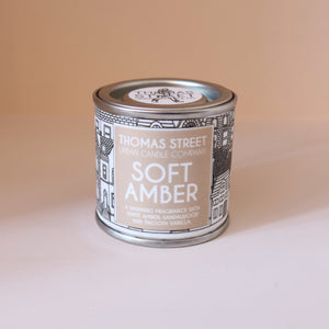Soft amber scented candle in a tin, 80g