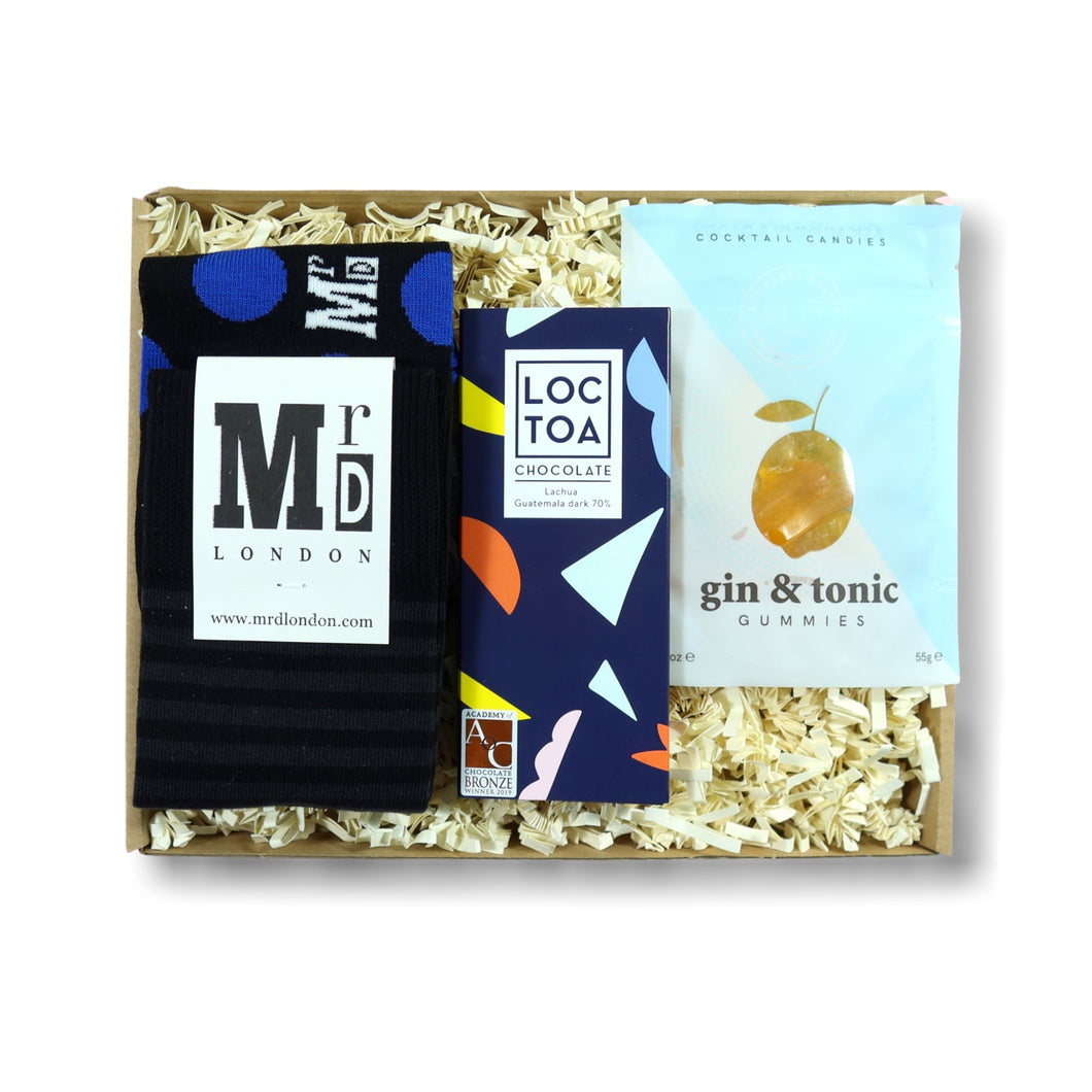 letterbox gift for men includes socks, sweets and chocolate