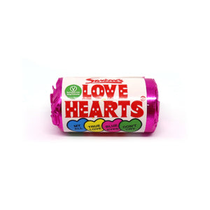 Mini packet of Swizzels love hearts against a white background