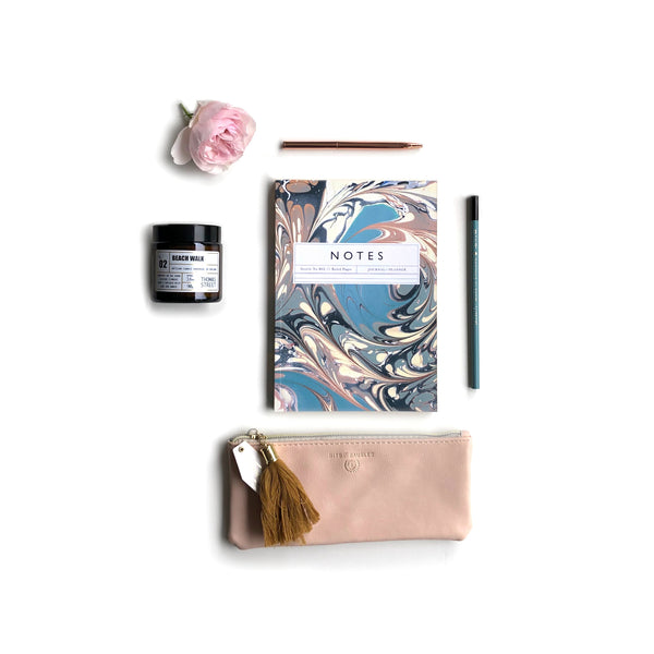 Katie Leamon luxury notepad and teal pencil, blush pink zip pouch, scented candle and pen