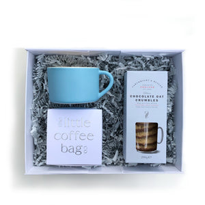Boxed gift set with a blue mug, coffee bags and oat crumble biscuits