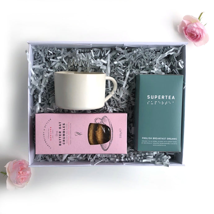 Gift box with luxury tea bags, biscuits and a designer ceramic white mug