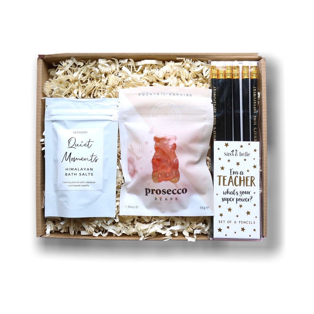 Thank you letterbox gift for teachers filled with Prosecco flavoured gummy sweets, Himalayan bath salts and a pencil set.