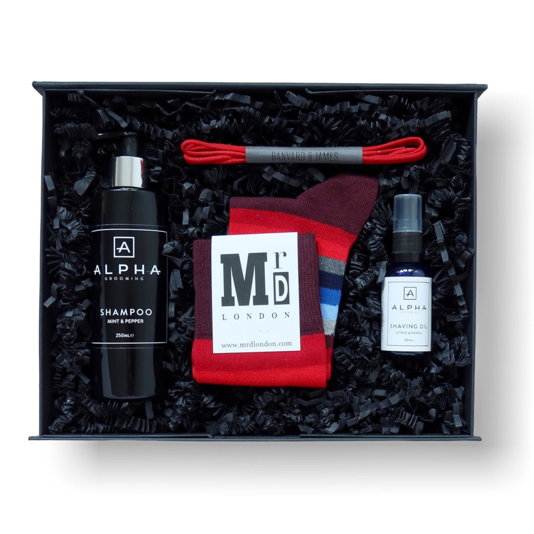 gift box for men with mint and pepper shampoo, shave oil, red striped socks and red laces