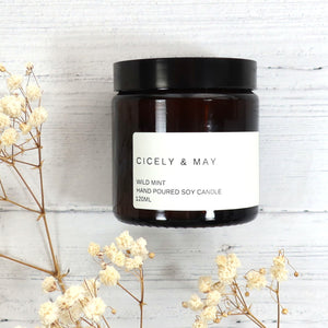 Cicely and May wild mint scented soy wax candle in a glass apothecary jar