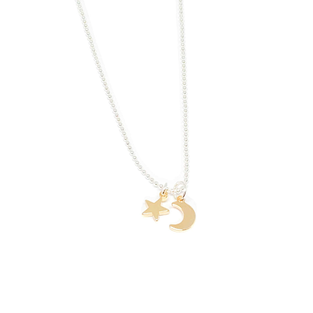 silver necklace with gold moon and star charms