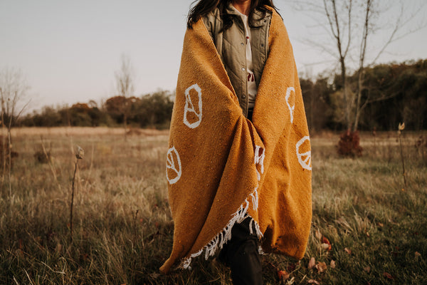 blanket, blankets, blanket bundle, horizon blanket, outdoor blanket, outdoor, yoga, beach, picnic, camping, made ethically, ethically made, ethical product, sustainable, sustainably made, indigenous artisans, artisans, tree, planting trees, tree planted, handmade, handmade products, peace, peace blanket, yellow