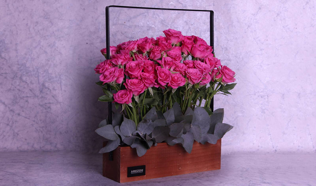 Flower Gifts - A wooden basket with pink spray roses
