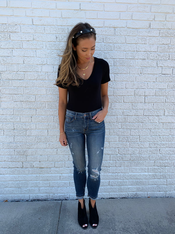 Distressed skinny crop jean