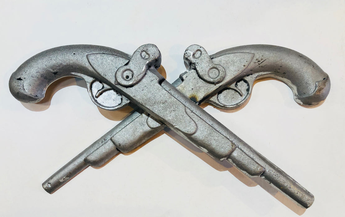 Jean Lafitte Pistols by Candice Alexander, Louisiana Artist. Re Creation of the i10 Calcasieu River Bridge Aluminum