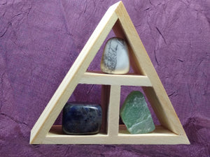 This wooden handcrafted triangle is made of fir and holds three stones and crystals intuitively selected to help you in your intentions for increasing peace and calm in your life.