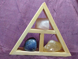 This handcrafted wooden triangle is made of fir and holds three stones and crystals intuitively selected to help you in your intentions of creative expression for artists and writers, although, any creative problem solving would be greatly enhanced with this collection.