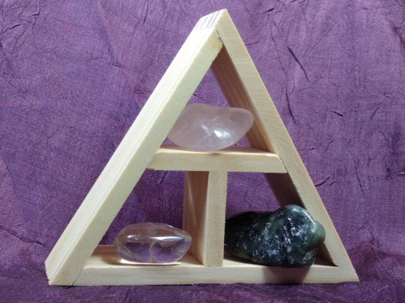 This handcrafted wooden triangle is made of fir and holds three stones and crystals intuitively selected to help you in your intentions of love.