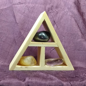 This handcrafted wooden triangle is made of fir and holds three stones and crystals intuitively selected to help you in your intentions for positive workplace energy.
