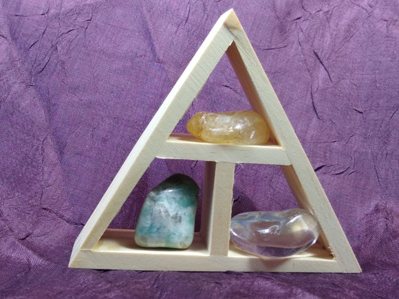 This handcrafted wooden triangle is made of fir and holds three stones and crystals intuitively selected to help you in your intentions for abundance and prosperity.