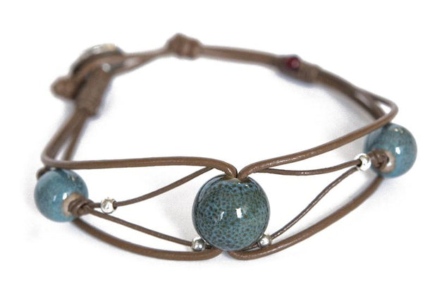 Aqua natural stone, pearl colored seed beads, leather