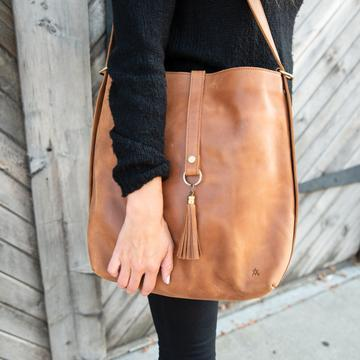 camel leather slingback bag on woman