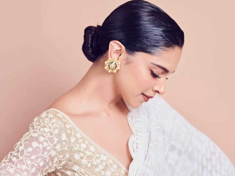 Low bun earrings diwali hairstyle deepika padukone