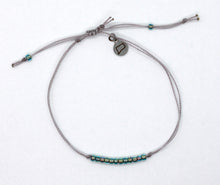 Load image into Gallery viewer, Sparkly Aqua Seed Bead Minimalist Bracelet with Grey Cord