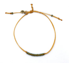 Load image into Gallery viewer, Sparkly Green Lined Transparent Aqua Seed Bead Minimalist Bracelet with Marigold Cord