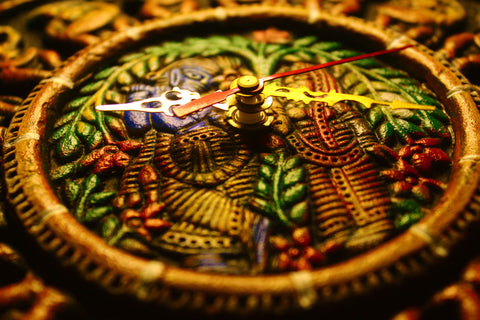 Terracotta wall clock with ethnic design