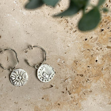Wavy hoop earrings with sun & moon charms