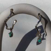 Wavy hoop earrings with dainty turquoise charms