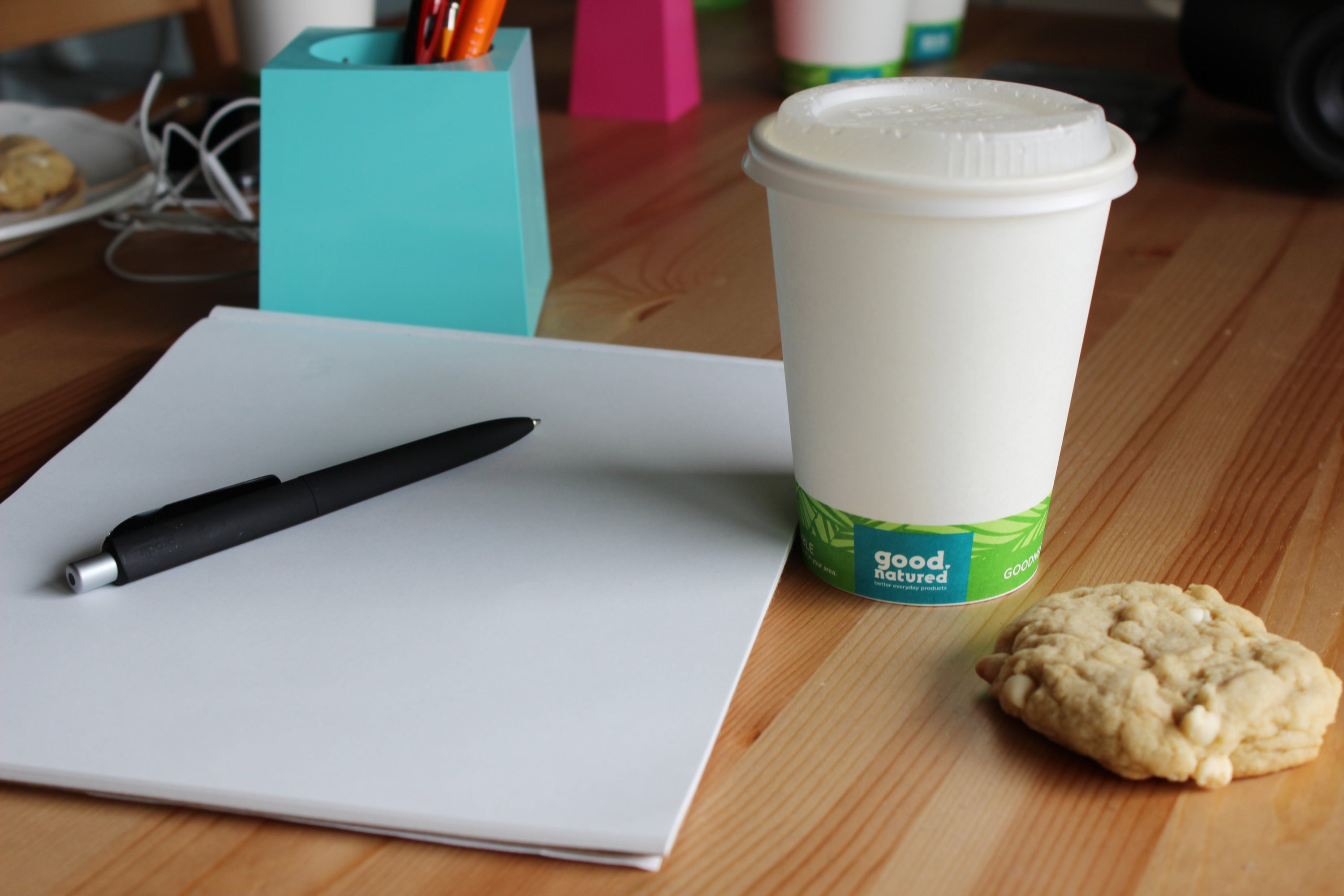 compostable coffee cup with compostable lid at desk