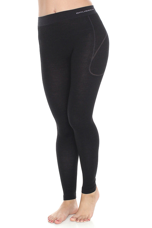 Women's fitted black athletic full-length leggings. High-waisted with a small BRUBECK logo on the left hip, and slight light-grey accents around the hips of the garment