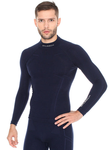 Men's EXTREME WOOL deep navy blue long-sleeve shirt. The fitted base layer features a white BRUBECK logo on the collar, and on the left forearm