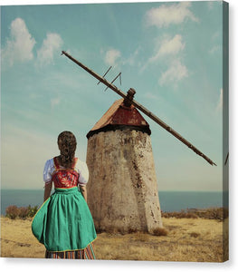 Canarian peasant in national costume walkind towards the windmill