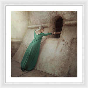 Blonde woman in green long dress giving her hand to prisoner in the dungeon