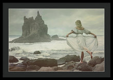 Load image into Gallery viewer, Young blonde woman standing on a rock in sea and holding her dress