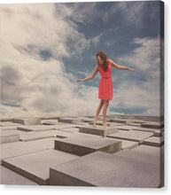 Load image into Gallery viewer, Woman in a red dress standing on the floor made out of cubes.