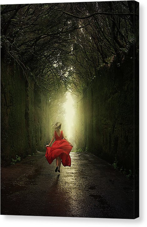 Blonde woman in red dress running to the light in the mysterious tunnel in the woods