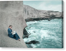 Load image into Gallery viewer, Woman in a long blue dress reading book on the cliff by the ocean. Tajao, Tenerife, Canary islands