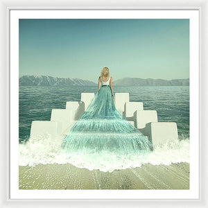 Woman in the water dress walking on stairs rising from the ocean.