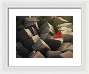Woman In A Long Red Dress On Stone Cubes Pier - Framed Print
