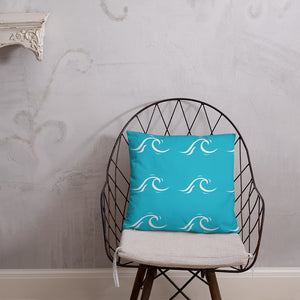 Wave print pillow on a chair.