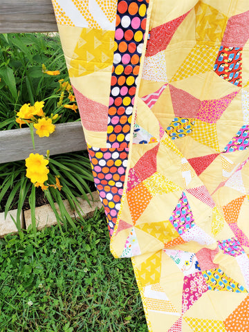 Toucan Fiesta Throw Quilt and D'Or Day Lilly