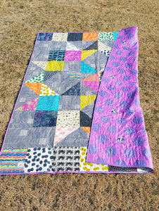 front and backing of bright and bold twin quilt from La Rue de Fleurs