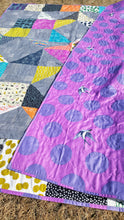 Load image into Gallery viewer, backing detail of bright and bold twin quilt from La Rue de Fleurs