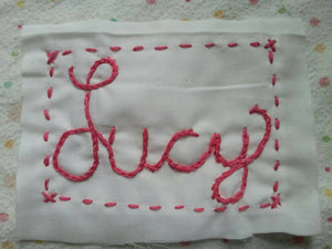 Hand Embroidered Name Tag.  Add a Hand Embroidered Name Tag to a Custom or Stock Quilt Purchase