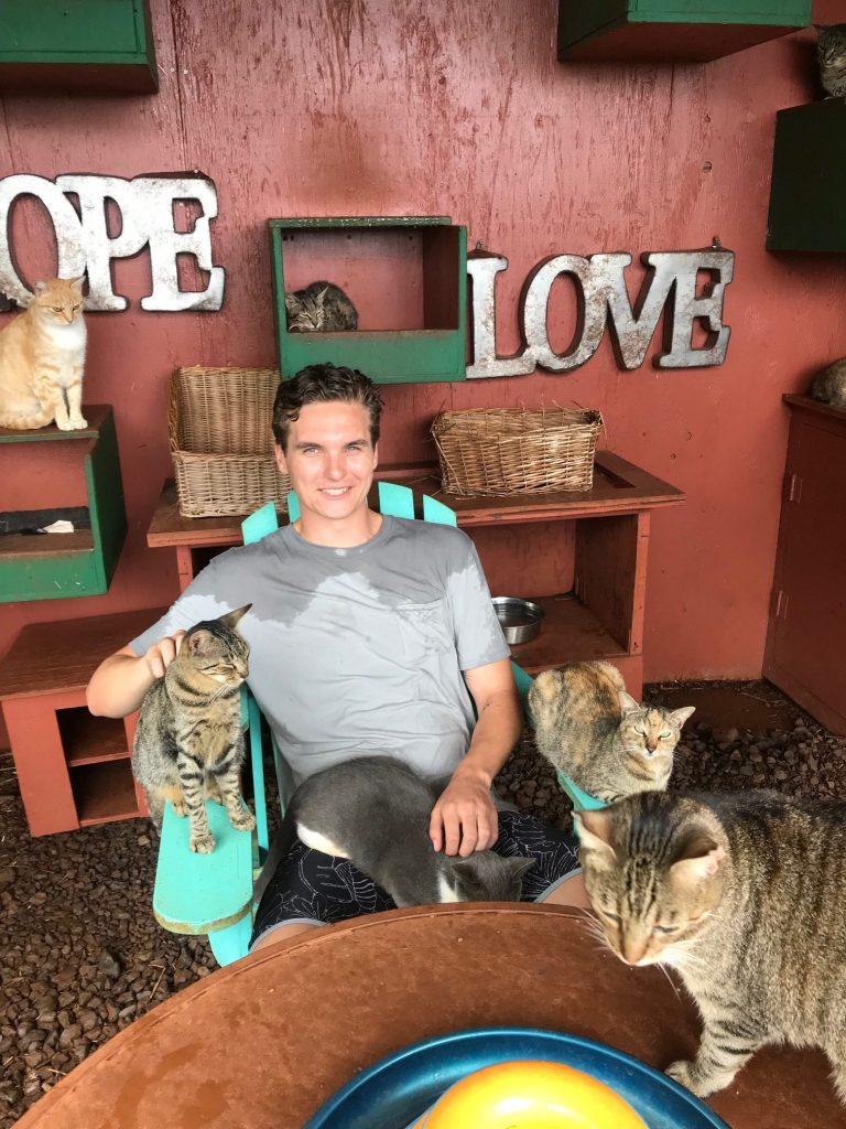 Seth, son of UV Skinz founder Rhonda and her late husband Darren, hang out with furry friends at the Lanai Cat Sanctuary in Hawaii. He's also wearing his UV Skinz.
