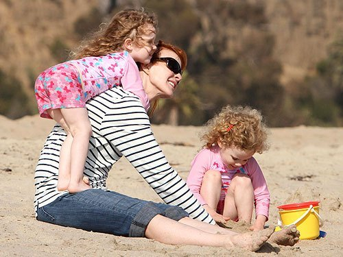 Marcia Cross's kids in UV Skinz