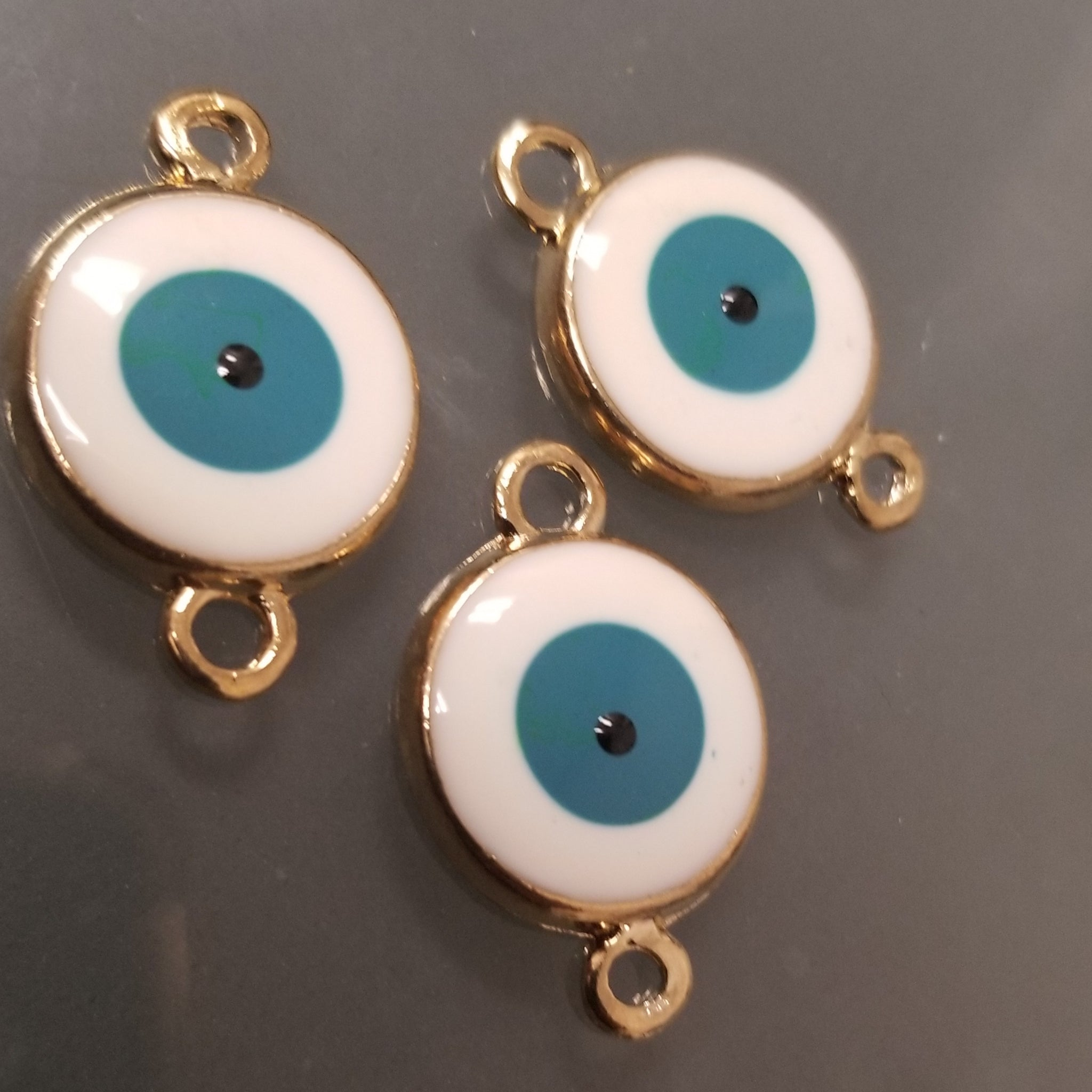 Teal Round Gold Evil Eye Charm