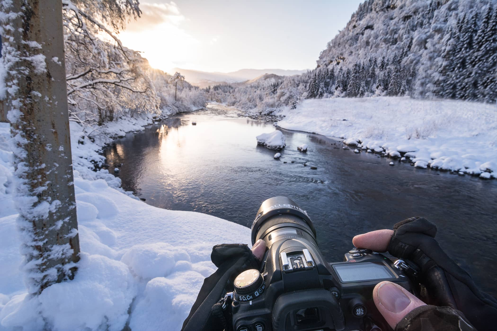 photographing a river in winter