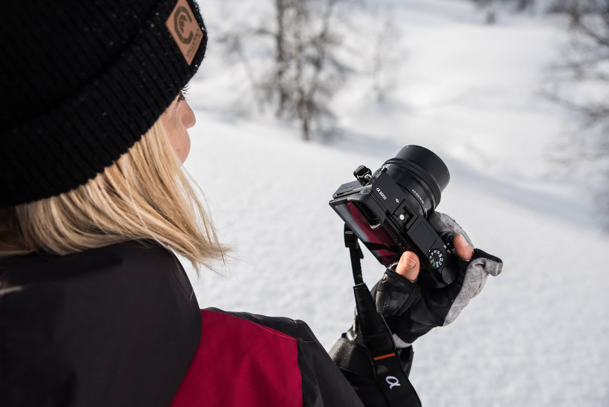 woman wearing gloves taking a photo