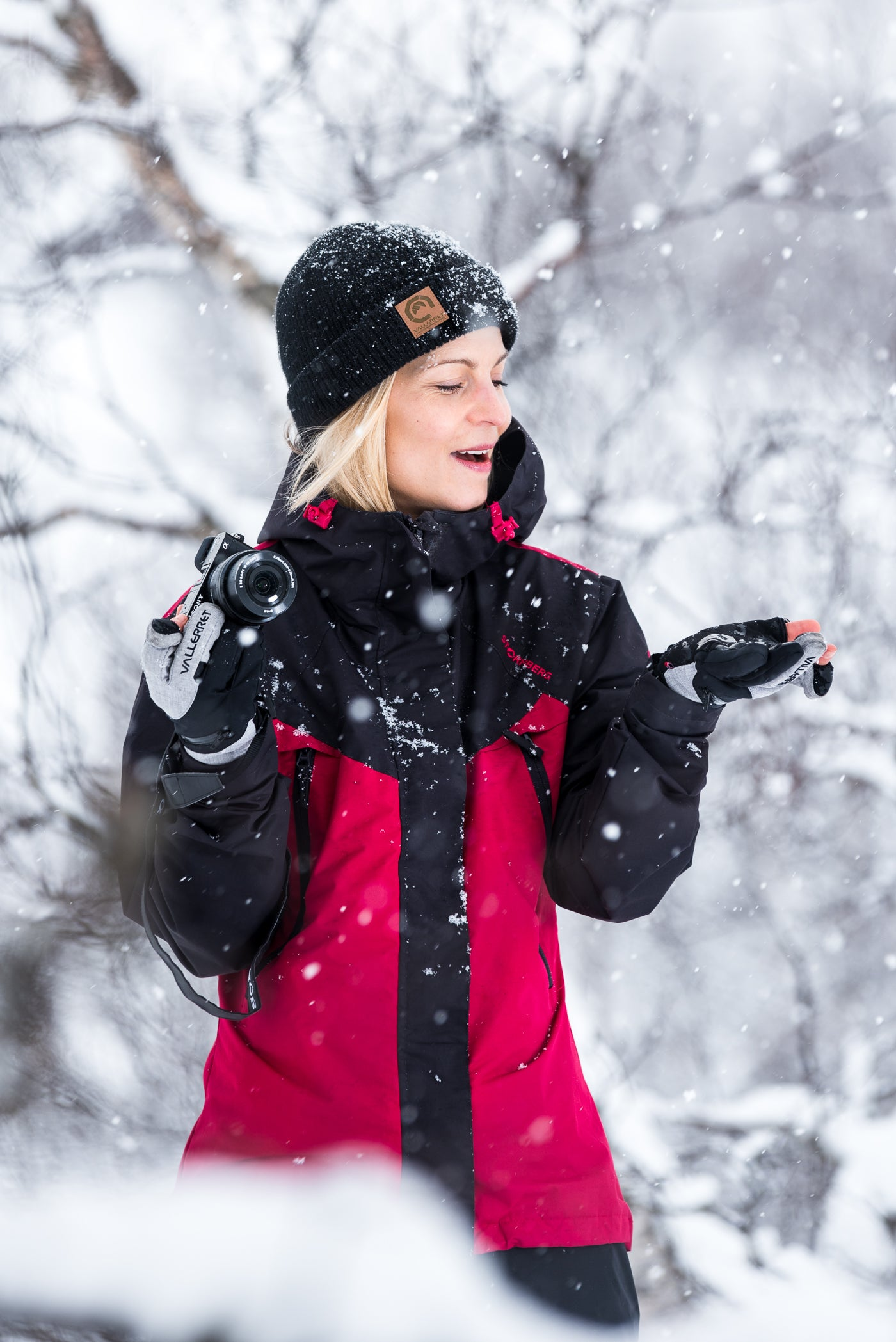 woman with camera in the snow