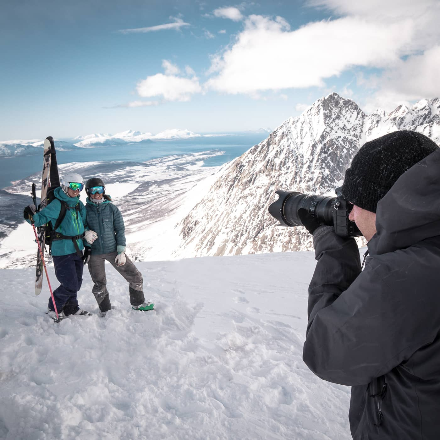 photographer taking a photo of people in snow